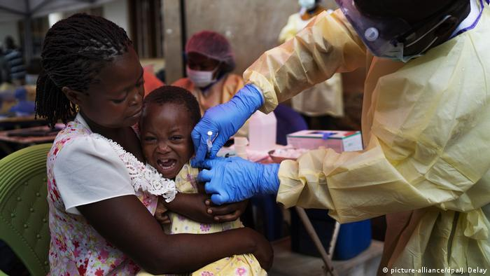 A child being vaccinated against Ebola ion Beni, Congo