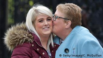 Sarah Ewart (L) is kissed by her mother after the Belfast court decided an abortion case in her favor