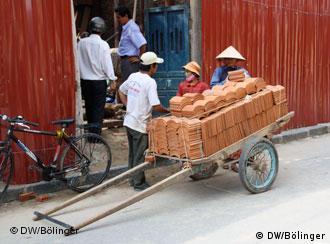 Wanderarbeiter im vietnamesischen Hoi An