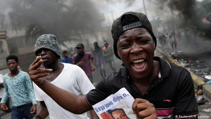 A person gestures during a protest to demand the resignation of Haitian President Jovenel Moise, in Port-au-Prince