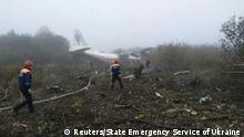 Members of emergency services work at the site of the Antonov-12 cargo airplane emergency landing in Lviv region, Ukraine October 4, 2019. State Emergency Service of Ukraine/Handout via REUTERS ATTENTION EDITORS - THIS IMAGE HAS BEEN SUPPLIED BY A THIRD PARTY. NO RESALES. NO ARCHIVES. MANDATORY CREDIT.