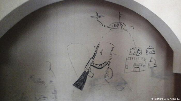 A drawing shows a machine gun and helicopter attacking a village