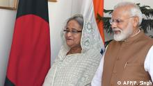 India's Prime Minister Narendra Modi (R) walks with Bangladesh's Prime Minister Sheikh Hasina prior to a meeting in New Delhi on October 5, 2019. (Photo by PRAKASH SINGH / AFP)