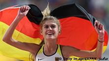 Germany's Konstanze Klosterhalfen celebrates placing third in the Women's 5000m final at the 2019 IAAF Athletics World Championships at the Khalifa International stadium in Doha on October 5, 2019. (Photo by KARIM JAAFAR / AFP) (Photo by KARIM JAAFAR/AFP via Getty Images)