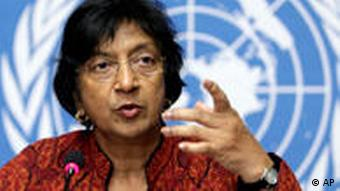 U.N. High Commissioner for Human Rights South African Navanethem Pillay gestures during a press conference at the European headquarters of the United Nations in Geneva, Switzerland, Tuesday, Dec. 8, 2009. Libya should release two Swiss businessmen it has sentenced to 16 months in jail for visa infractions in a spat with Switzerland involving leader Moammar Gadhafi's son, the U.N. human rights chief said Tuesday. The businessmen Max Goeldi and Rachid Hamdani were detained in July 2008 on alleged visa violations, days after Swiss police arrested Gadhafi's son Hannibal and his wife for allegedly beating up their servants in a Geneva hotel. (AP Photo/Keystone/Salvatore Di Nolfi)