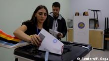 People cast their ballots at a polling center in Pristina, Kosovo, October 6, 2019, REUTERS/Florion Goga