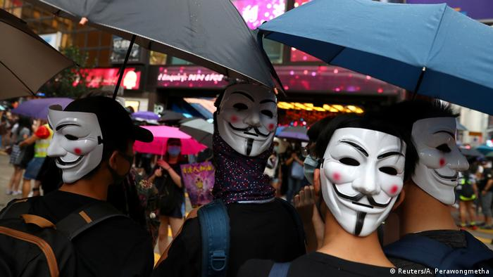Anti-government protesters wear masks during a demonstration at Causeway Bay district, in Hong Kong, China October 6, 2019.