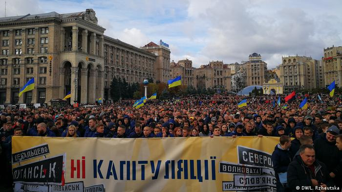 Protesters fill downtown Kyiv to speak out against President Volodymyr Zelenskiy's plan to allow location elections in the violence-ridden Donbas region