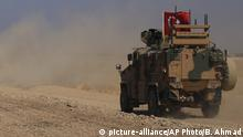 A Turkish n armored vehicles patrol as they conduct a joint ground patrol with American forces in the so-called safe zone on the Syrian side of the border with Turkey, near the town of Tal Abyad, northeastern Syria, Friday, Oct.4, 2019. The patrols are part of a deal reached between Turkey and the United States to ease tensions between the allies over the presence of U.S.-backed Syrian Kurdish fighters in the area. (AP Photo/Baderkhan Ahmad) |