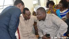 Tanzania opposition party leader Freeman Mbowe (CHADEMA), with Tarime constituency MP John Heche talking lawyer John Mallya during court hearing at Kisutu High court. Mbowe and other CHADEMA leaders are facing sedition chages.