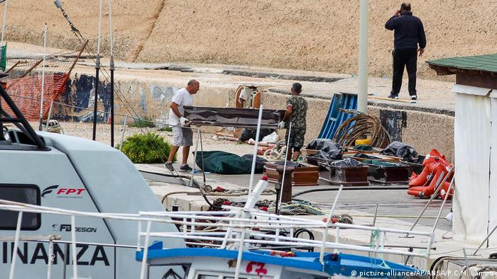 Coffins containing the bodies of refugees drowned at sea in Lampedusa Harbor in Italy