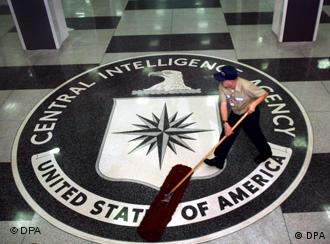 A janitor sweeps the floor at CIA headquarters