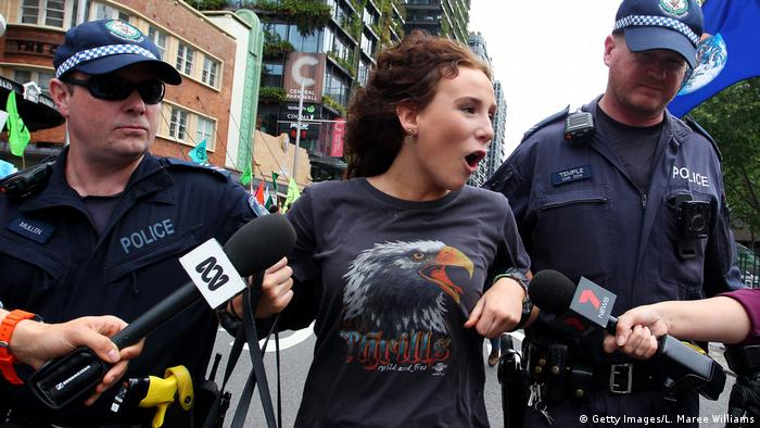 Police arreset an Extinction Rebellion protester in Sydney, Australia