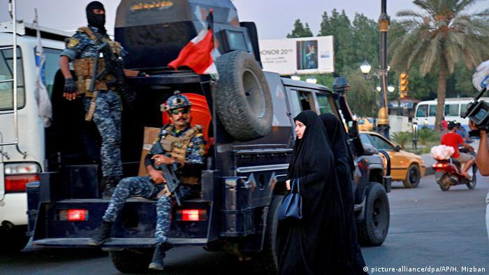 Вооруженные силовики на улицах Багдада