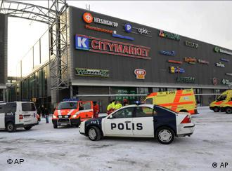 Police vehicles and ambulances outside the Sello shopping center in Espoo, Finland