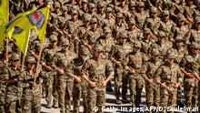 22.09.2019 Female fighters of the Syrian Democratic Forces (SDF) attend their graduation ceremony at the female cadets academy in the northeastern Syrian town of Amuda on September 22, 2019. (Photo by Delil SOULEIMAN / AFP) (Photo credit should read DELIL SOULEIMAN/AFP/Getty Images)