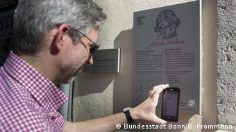 person holding a phoen to a QR code
