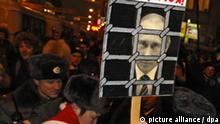 Russian riot police detain a participant of an illegal 'Dissenters march', which unites non-comformist democratic opposition in central Moscow, Russia 31 December 2009. About 30 people were arrested in Moscow shortly before the start of an unauthorized demonstration against the policies of Russian Prime Minister Vladimir Putin. On poster with pictures of Russian Prime minister Vladimir Putin reads 'Await!'. EPA/SERGEI ILNITSKY