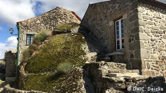 The houses of the village are partly built in granite rocks
