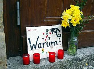 Why? read a sign outside the Erfurt school after the shooting in 2002