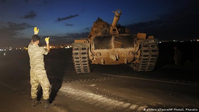 Soldier guiding a tanker