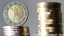 Euro coins balanced on eachother