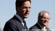 Prime Minister of Netherlands Mark Rutte, left, and Australian Prime Minister Scott Morrison brief the media following meetings in Sydney, Wednesday, Oct. 9, 2019. Rutte is on a three-day visit to Australia. (AP Photo/Rick Rycroft)
