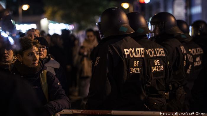 Riot police look on as Bavarian Pegida members demonstrate in Berlin