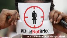 FILE- In this Saturday, July 20, 2013, file photo, a woman protests against underage marriage in Lagos, Nigeria. Child marriage affects nearly 15 million girls around the world, and West and Central Africa has six of the 10 countries with the highest rate. (AP Photo/Sunday Alamba, File) |