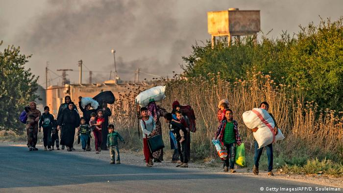 Civilians from the northern Syria border region flee the fighting in the region.