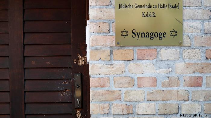 The damaged door of a synagogue is seen in Halle, Germany