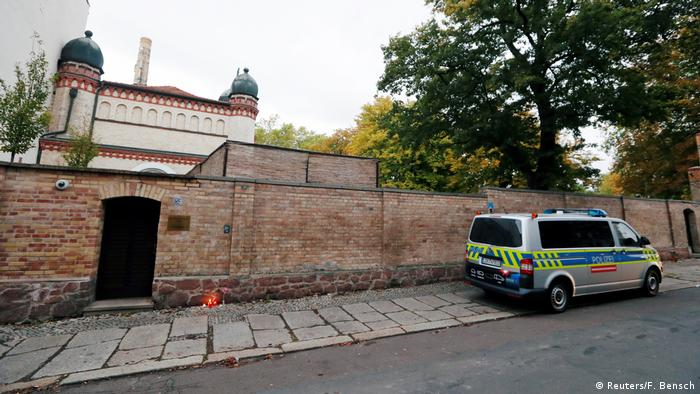 A police vehicle is seen next to a synagogue in Halle, Germany following a nearby shooting