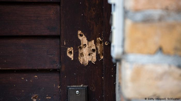 View of the entrance door to the Jewish synagogue with the bullet holes from yesterday's raid on October 10, 2019 in Halle, Germany. Law enforcement authorities, after initially speaking of multiple attackers, are now referring to a single attacker who has been apprehended.