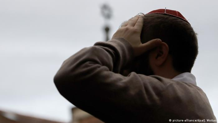 A member of the Halle Jewish community stands next to its synagogue after an attempted attack