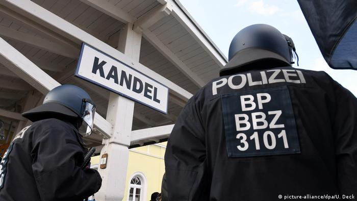 Police secure the train station in Kandel, Germany in 2018 amid protests over a teen's death
