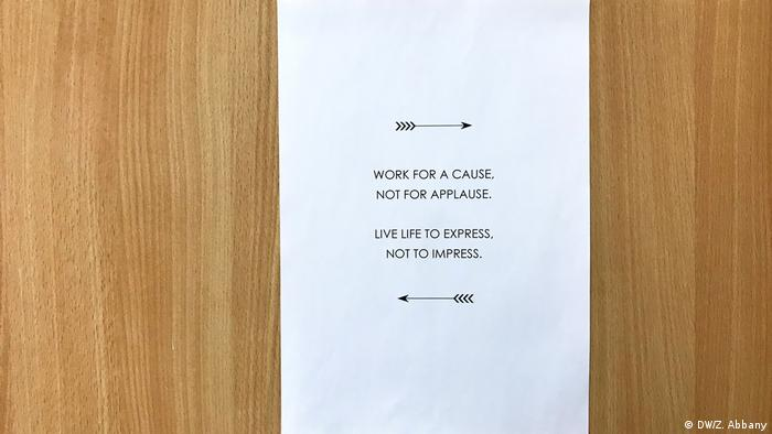 Inspirational note on someone's office door: Work for a cause, not for applause. Live life to express, not to impress. (DW/Z. Abbany)