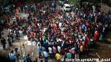 Students of Bangladesh University of Engineering and Technology (BUET) block a road and take part in a protest in Dhaka on October 10, 2019, after a pupil was allegedly beaten to death by ruling party activists. - Bangladesh's Prime Minister on October 10 vowed to mete out the highest punishment to the killers of a university student who died after he criticised a deal the leader made with India. (Photo by REHMAN ASAD / AFP) (Photo by REHMAN ASAD/AFP via Getty Images)