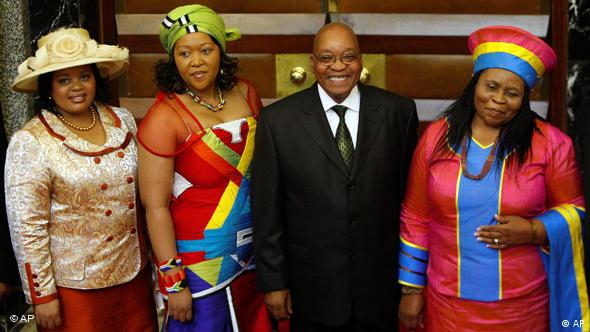 South African President Jacob Zuma, with his three wives. Critics say his firing of finance Minister Nene was politically motivated.