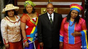 In this June 3, 2009 file photo, South African president Jacob Zuma, second right, seen with his wives Sizakele Khumalo, right, Nompumelo Ntuli, left, and Tobeka Madiba, second left, after giving the State of the Nation address, at parliament in Cape Town, South Africa. The South African president's office on Sunday, Jan. 3, 2010 said he is set to marry Madiba in a formal wedding ceremony this week. (AP Photo/Mike Hutchings, Pool, File)