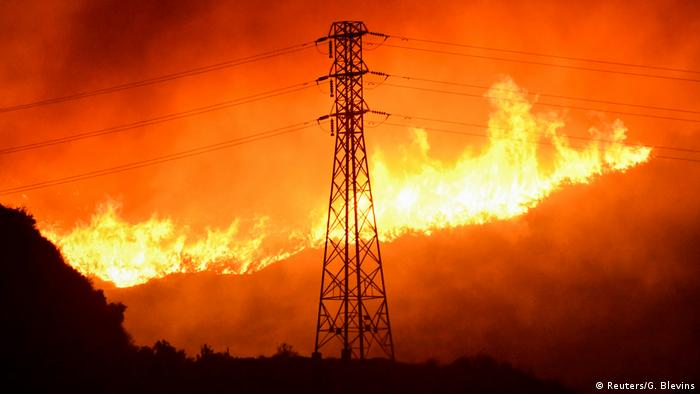 Power lines surrounded by wildfire