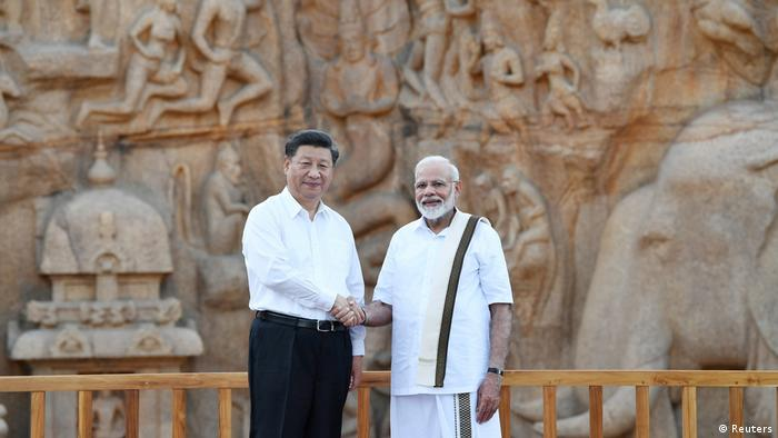 China's President Xi Jinping shakes hand with India's Prime Minister Narendra Modi during their visit to Arjuna's Penance in Mamallapuram on the outskirts of Chennai, India, October 11, 2019