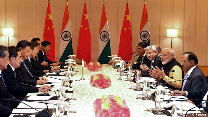India's Prime Minister Narendra Modi (3rd R) and China's President Xi Jinping (3rd L) attend delegation level talks in Mamallapuram on the outskirts of Chennai, India, October 12, 2019