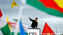 A Kurdish protester waves a flag during a demonstration against Turkey's military action in northeastern Syria, in Cologne, Germany, October 12, 2019. REUTERS/Thilo Schmuelgen