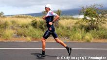 Jan Frodeno running in the Ironman World Championships in Hawaii