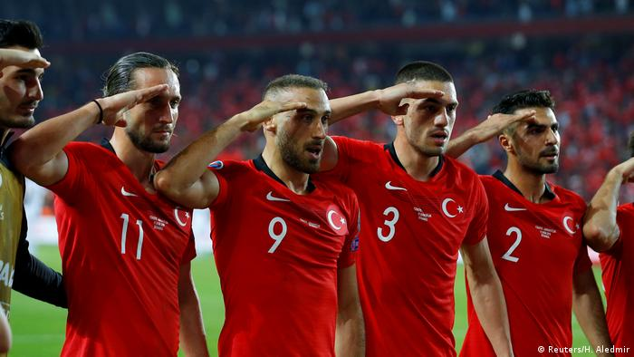 Turkish players perform the military salute
