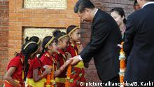 Chinese President Xi Jinping is greeted by Nepalese children upon arrival in Kathmandu, Nepal, Saturday, Oct 12, 2019. Xi on Saturday became the first Chinese president in more than two decades to visit Nepal, where he's expected to sign agreements on some infrastructure projects.(Bikash Karki/Pool Photo via AP)  