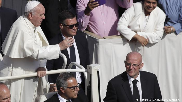 Domenico Giani seen next to pope in the popemobile