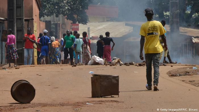 Protesters block a road in Conakry