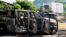 Burned police car in Michoacan, after cartel ambush