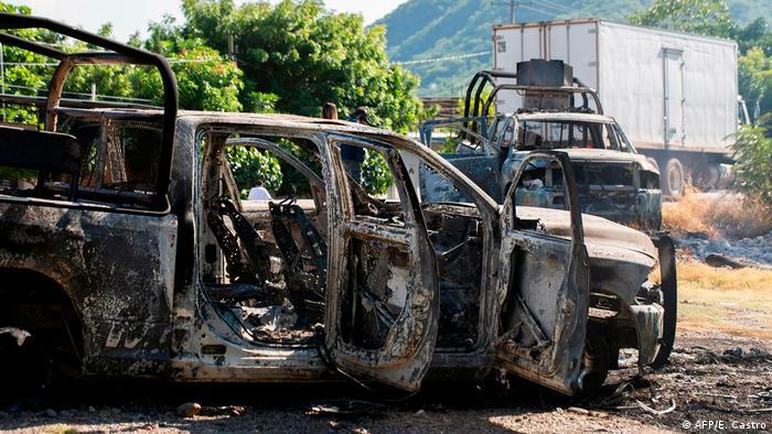 Burned police car in Michoacan, after cartel ambush